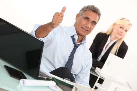 Estate agent with thumbs up Stock Photo - 16227815