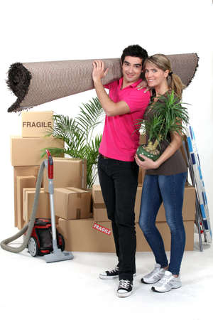 cardboard house: Young couple moving house