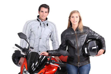 A man, a woman and a motorbike. photo