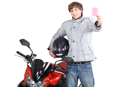 Young person with motorbike license photo