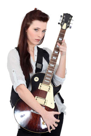 Brunette posing with electric guitar photo