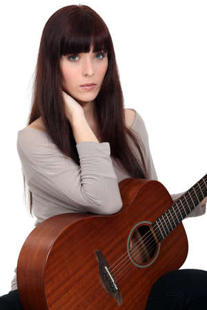 Woman beat guitar: Woman with guitar