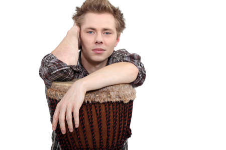 Young man with a djembe drum photo