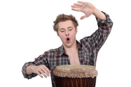 bongo drum: Enthusiastic man playing the bongo drum