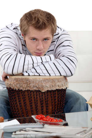 verticals: Man with his arms on his drum Stock Photo