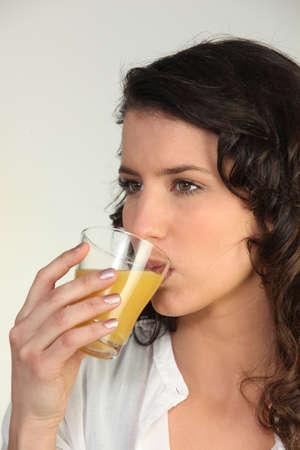 chilled: Woman drinking orange juice