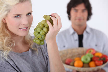 Woman with bunch of grapes Stock Photo - 16236843