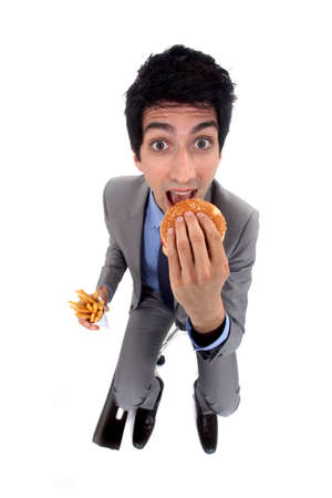 A businessman devoring a burger. photo