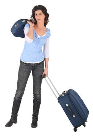 full suspended: Woman with suitcases