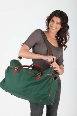 Woman with bag ready to go photo