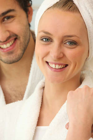 Couple in bath robes getting ready Stock Photo - 16324351