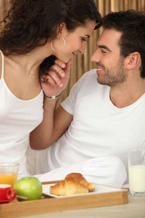 Couple enjoying room service photo