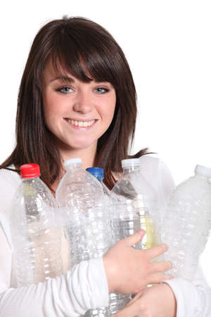 Brunette recycling plastic bottles Stock Photo - 16323919