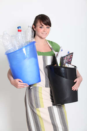 Brunette holding recyclable plastic photo
