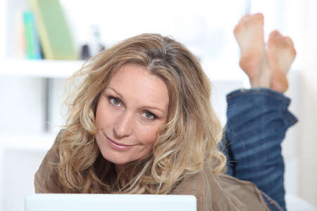 microcomputer: Blond woman on laptop Stock Photo