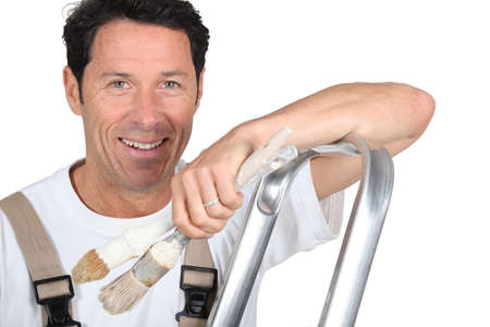 handsome old man: Painter with a stepladder Stock Photo
