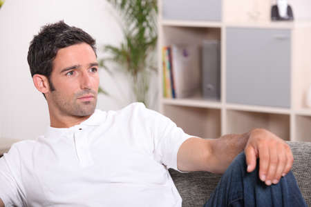 cogitate: man resting on his sofa