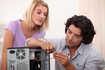 technical support: man repairing a computer