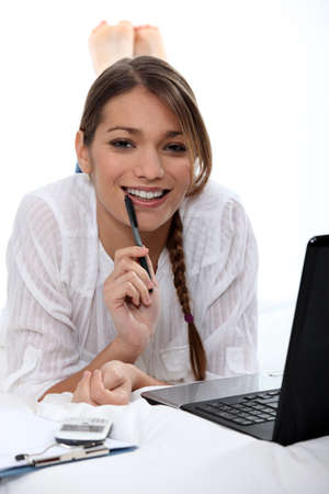 Woman biting pen Stock Photo - 16323692