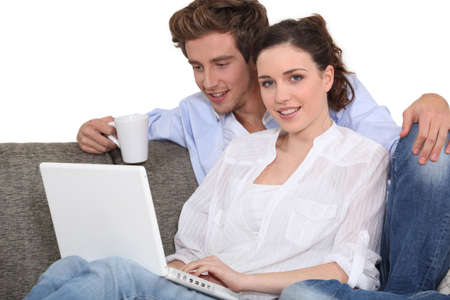 lovely couple with laptop indoors Stock Photo - 16324016