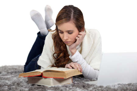 Girl lying down reading photo