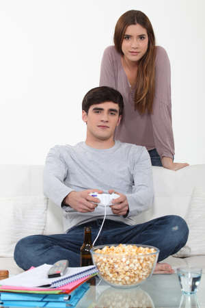 span: Man being distraction studies by video games