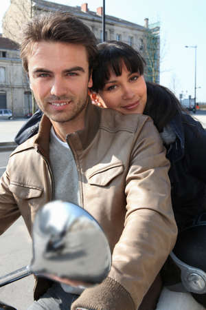 Couple on a moped photo