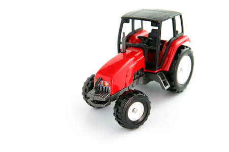 farm implement: Red toy tractor