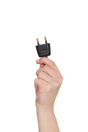 electric plug: Hand holding electrical outlet