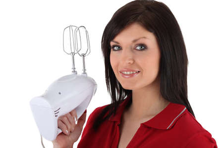 to incorporate: Woman holding up a mixer
