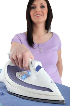 Housewife ironing photo