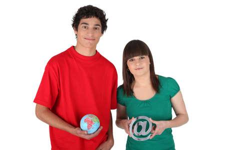 Teens with globe Stock Photo - 16336740