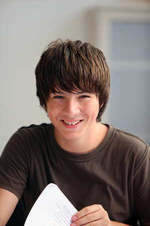 portraiture: Teenage boy turning a page Stock Photo