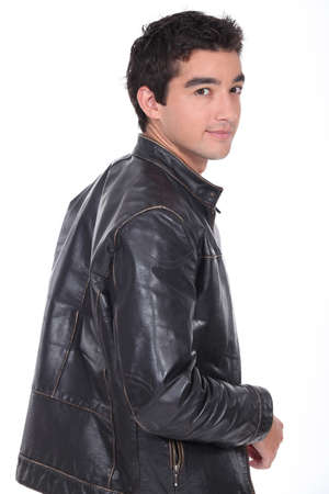 bad boy: portrait of a young man with leather jacket
