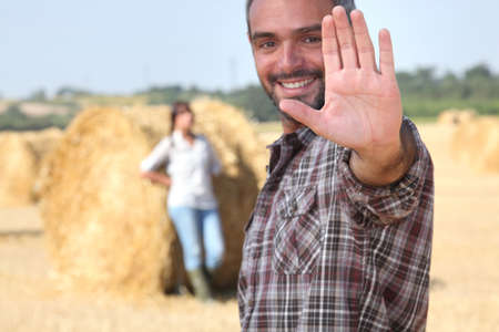 bale: Couple on agricultural land Stock Photo