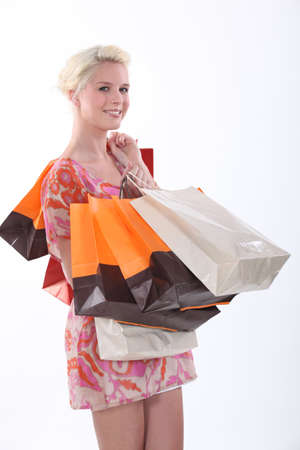 Female shopper and her many bags Stock Photo - 16336762