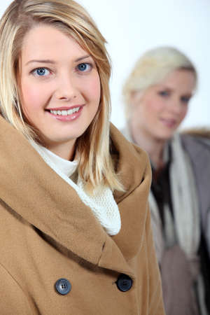 Two women dressed in winter clothing Stock Photo - 16336889