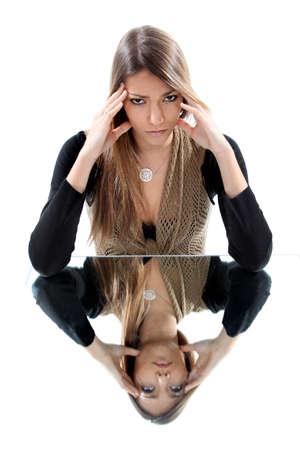 urging: Woman with headache mirror