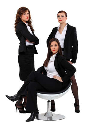 three sexy women in suits photo