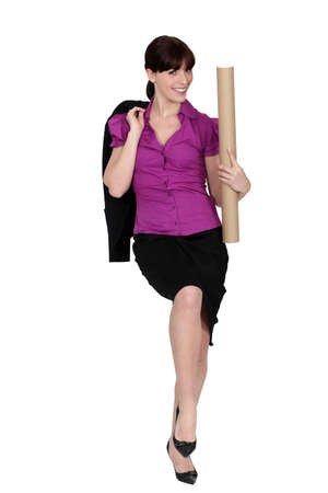 Businesswoman with a cardboard document tube photo