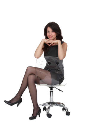 suit skirt: Attractive brunette sat seductively