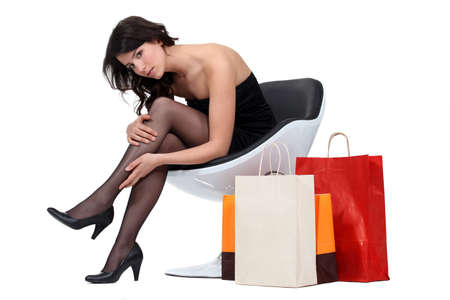 Brunette back from shopping Stock Photo - 16336751