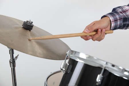 Drummer hitting a cymbal photo