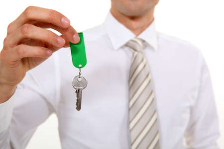 Businessman giving key Stock Photo - 16336757