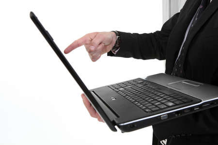 Male hand pointing to computer screen Stock Photo - 16423377