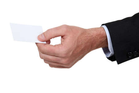 corporate waste: male hand giving visit card Stock Photo