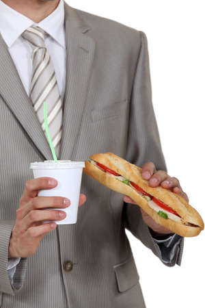 cravings: Businessman holding sandwich and soft drink