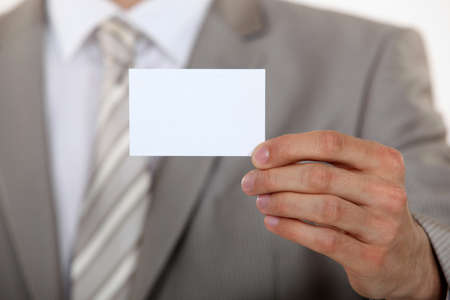 Man holding up a blank business card Stock Photo - 16423653