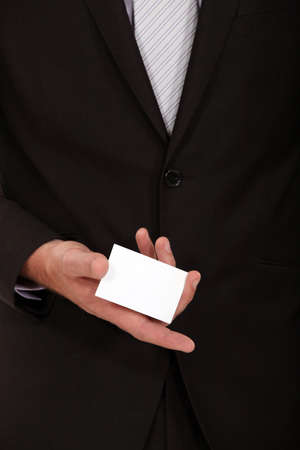Businessman presenting his calling card photo