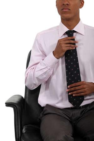 Businessman adjusting his tie Stock Photo